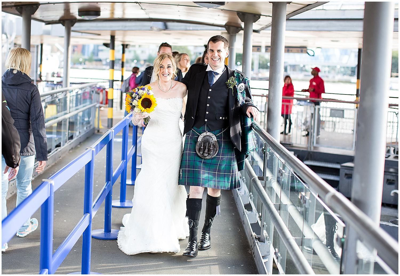 bride and groom at tower bridge pier