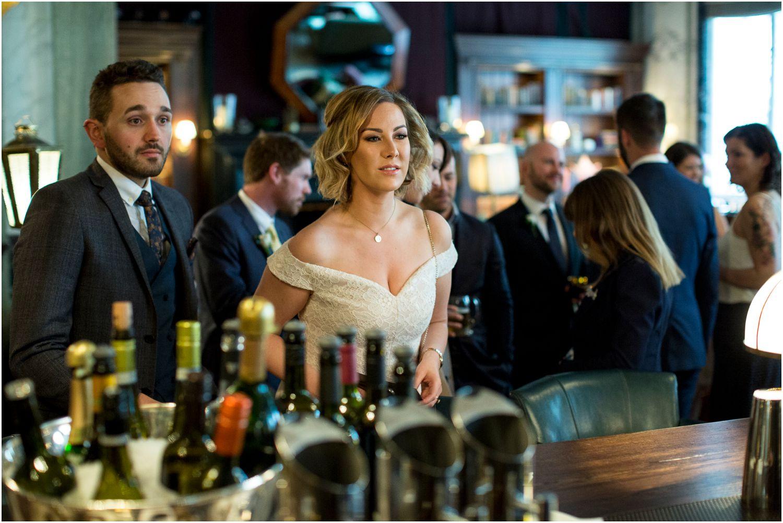 wedding guests meeting at scares bar at rosewood hotel