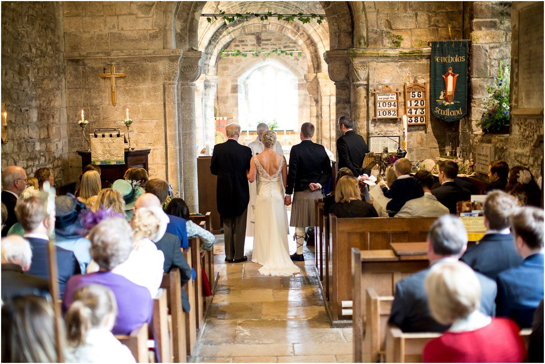 bride at the alter caught by Harry Warren House Dorset Studland Wedding Photographer