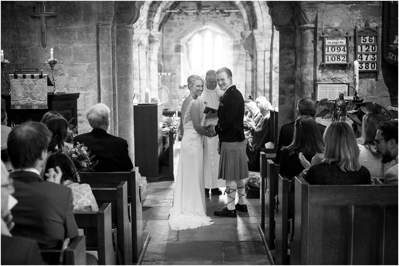 Harry Warren House Dorset Studland Wedding Photographer catches happy couple at the alter