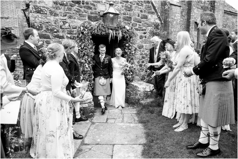 Harry Warren House Dorset Studland Wedding Photographer confetti as bride and groom exit church