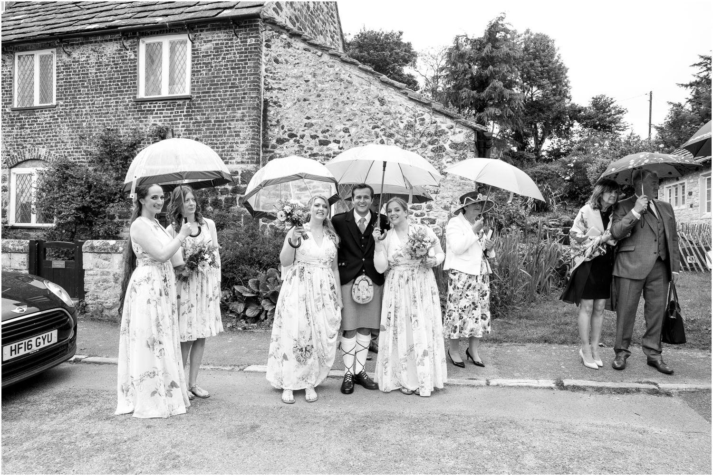 wedding umbrellas at st.nicholas church in studland dorset