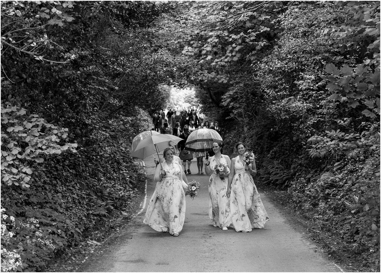 bridesmaids walking along at studland wedding
