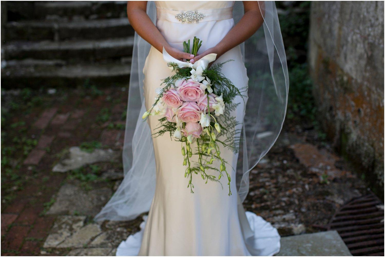 wedding flowers held by bride at wardour castle wedding