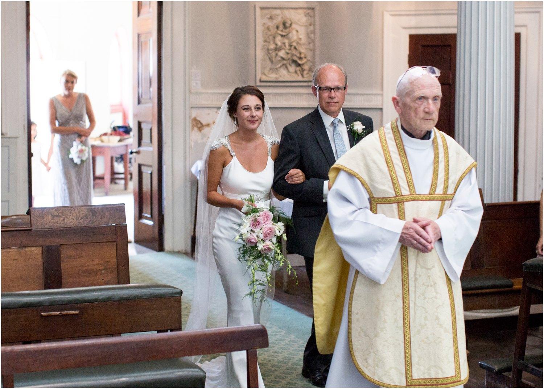 bride and father entering wardour castle wedding chapel in tisbury wiltshire